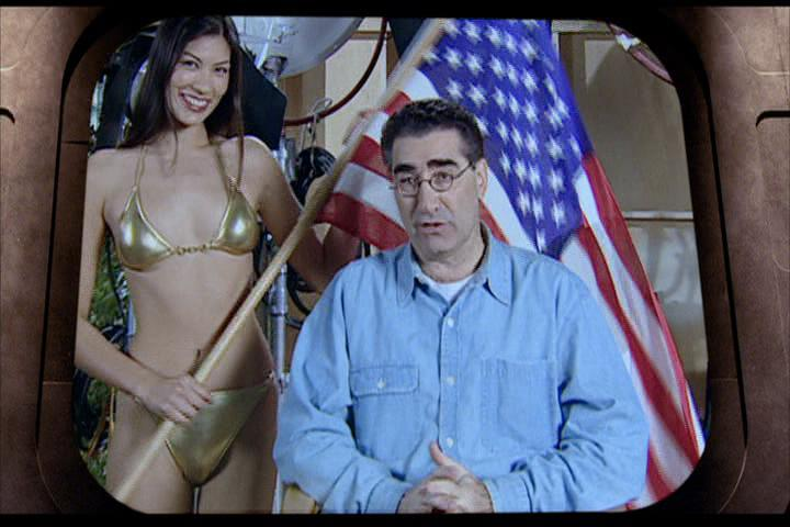 Josie-film-223-Eugene-Levy-woman-flag